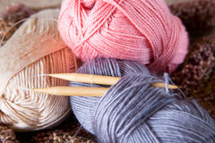 Yarn balls and round needles set Royalty Free Stock Images
