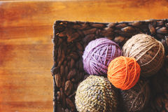 Yarn in a basket. Five balls of yarn sitting in a basket on a table stock images