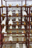 Yarn bobbins on loom Stock Images