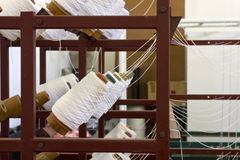 Yarn bobbins on loom framework Stock Photo