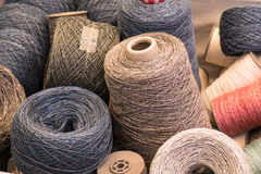 Yarn bobbins. Several yarn bobbins of different colors and sizes Stock Image
