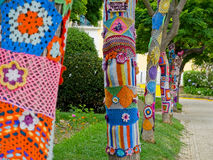 Yarn bombing in trees. European park. Royalty Free Stock Images