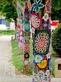 Yarn bombing in trees. European park. Royalty Free Stock Image