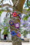 Yarn bombing in trees. European park. Stock Image