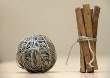 Yarn & cinnamon. Ball of yarn & cinnamon sticks Stock Images