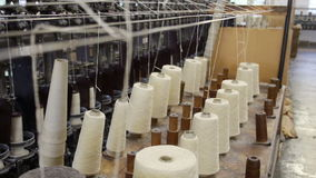 Yarn cones in a woolen mill in the UK stock video footage