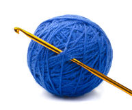 Yarn and crochet hook. Ball of blue yarn and crochet hook isolated on white royalty free stock photo