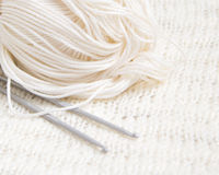 Yarn and crochet hook background Royalty Free Stock Images