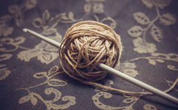 Yarn and crochet hook. A ball of linen yarn and a crochet hook. Photo toned Royalty Free Stock Photography