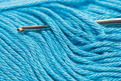 Yarn and crochet hook Stock Images