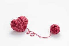 Yarn. Heart shaped red woolen yarn stock photography