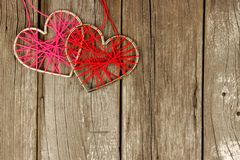 Yarn hearts together on rustic wood Royalty Free Stock Photography