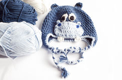 Yarn and hippo baby hat Stock Photos