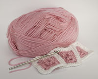 Yarn, Hook, and Crocheted Squares Stock Image