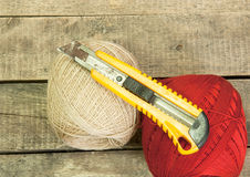 Yarn and knife Stock Image