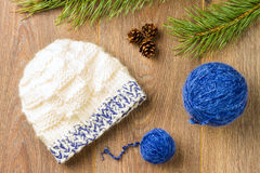 Yarn and knitting cap Stock Images