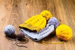 Yarn and knitting caps Royalty Free Stock Photos