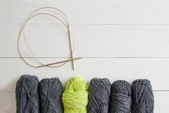Yarn for knitting with circular spokes on white wooden background. The concept of Hobbies, crafts, the beginning of a new knitting. Project royalty free stock image