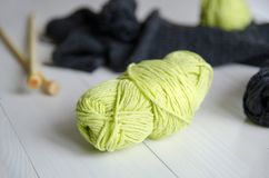 Yarn for knitting close-up on white wooden background. The concept of Hobbies, crafts, the beginning of a new knitting project.  stock photos