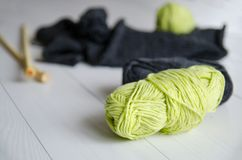 Yarn for knitting close-up on white wooden background. The concept of Hobbies, crafts, the beginning of a new knitting project.  stock photo