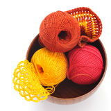 Yarn for knitting and cloth. In a wooden bowl on a white background Stock Images
