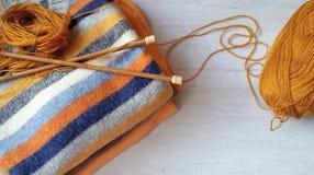 Yarn for knitting and handmade sweaters Stock Photo