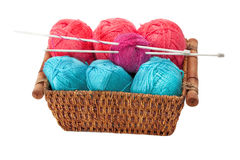 Yarn and knitting needles arranged in a basket Royalty Free Stock Photo