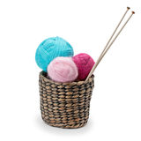 Yarn and knitting needles arranged in a basket. Isolated on white background Stock Photography