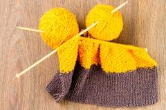 Yarn, knitting needles and scarf Stock Image