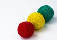 Yarn knitting. Red yellow green yarn knitting  white background Royalty Free Stock Photography
