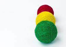 Yarn for knitting. Red yellow green yarn  knitting white background Royalty Free Stock Photo
