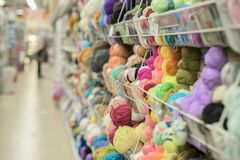 Yarn for knitting in the store. Colored multicolored yarn for knitting. Store shelves for craftsmen Stock Photos