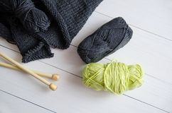 Yarn for knitting on white wooden background. The concept of Hobbies, crafts, the beginning of a new knitting project.  stock images