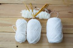 Yarn for knitting on wooden. Background Stock Images