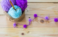 Yarn for knitting and Knitting tool. Yarn for knitting on wooden  background Royalty Free Stock Photos