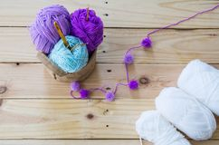 Yarn for knitting on wooden. Background Royalty Free Stock Photo