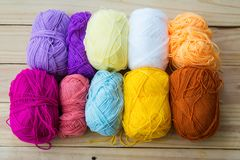 Yarn for knitting on wooden. Background Stock Photos