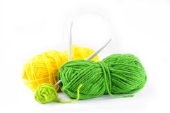 Yarn and needles for kniting. Green and yellow yarn and needles for knitting Stock Images