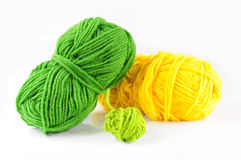 Yarn and needles for kniting. Green and yellow yarn and needles for knitting Royalty Free Stock Images