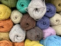 The yarn is a nice color on the shop window. Ready to crochet and knitting. royalty free stock photography