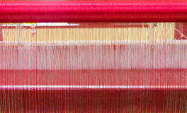 Yarn pattern is set up on the loom bench and ready to weave Stock Photography