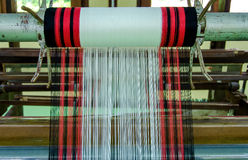 Yarn pattern is set up on the loom bench and ready to weave Stock Image