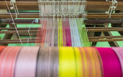 Yarn pattern is set up on the loom bench and ready to weave Stock Photo
