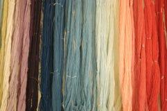 Yarn rainbow. Wool yarn hanging waiting to be woven royalty free stock photos