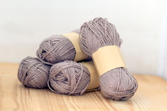 Yarn rolls. Grey yarn on wood background Royalty Free Stock Photos