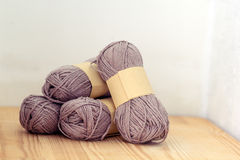Yarn rolls. Grey yarn on wood background Royalty Free Stock Image