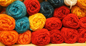 Yarn For Sale. Colorful Red, Yellow, Orange and Blue Skeins of Yarn royalty free stock image