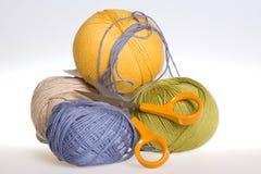 Yarn and scissors Royalty Free Stock Photos