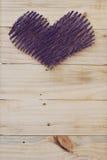 Yarn shape of heart on wooden board Royalty Free Stock Photos