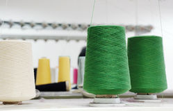 Yarn spin. Yarn rollers working on a spinning machine Royalty Free Stock Photo